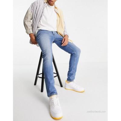 DESIGN skinny jeans in vintage light wash blue