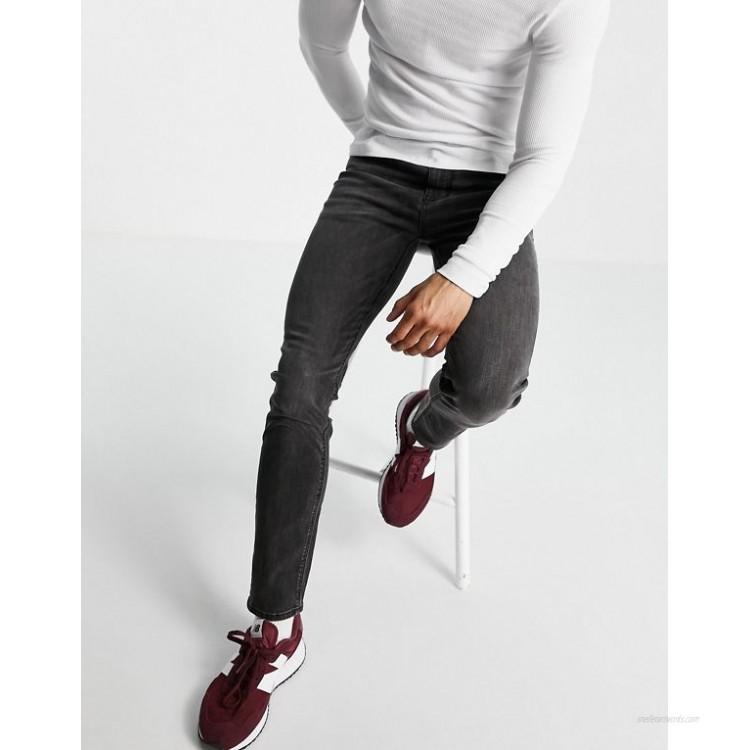 DESIGN skinny jeans in washed black