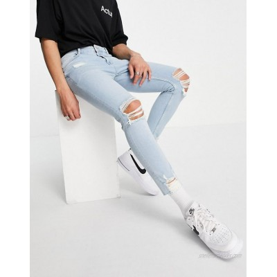 DESIGN skinny jeans with knee rips and destroyed hem in light wash blue