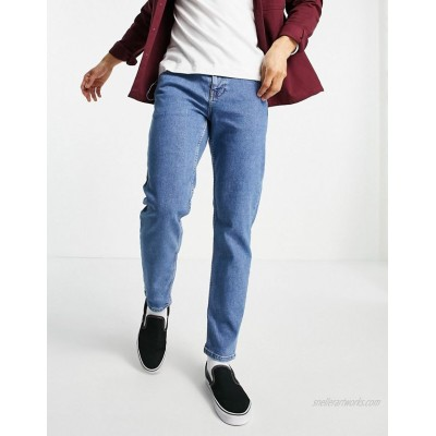 DESIGN tapered jeans in flat mid wash blue