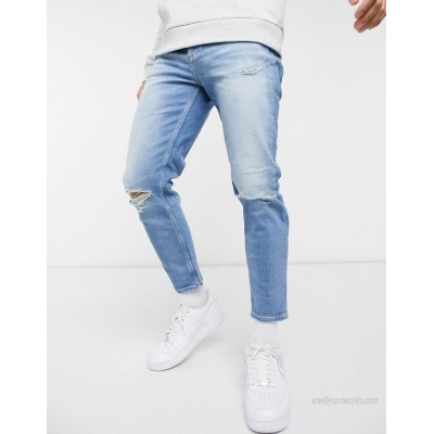 River Island tapered jeans with rips in light blue