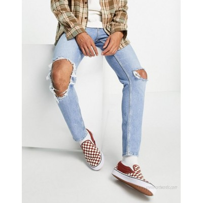DESIGN stretch slim jeans in vintage light wash with open knee rip